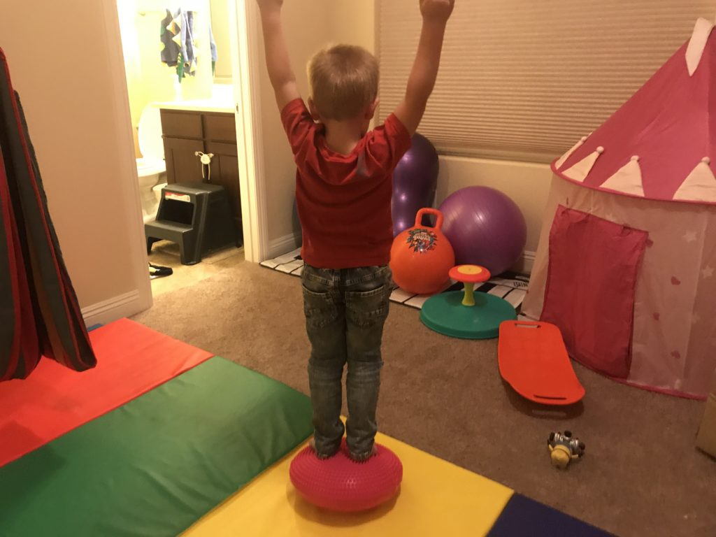 hyperactive son on inflatable stability disc